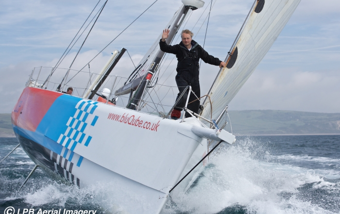 Steve White on the bow of his Volvo 70, the boat with which he will attempt the Westabout world record to be the fastest solo yachtsman  to circumnavigate the globe the 'wrong way' around.